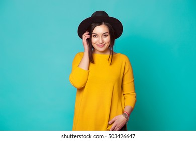 Trendy sexy young woman wearing casual clothes posing over green background