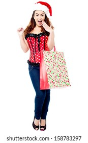Trendy shocked woman carrying polka bag