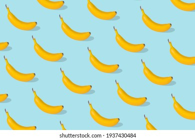 Trendy Summer food pattern made with fresh banana fruit on bright blue background. Minimal summer concept.