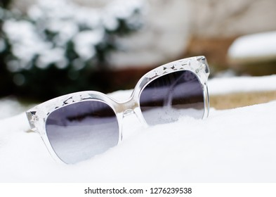 trendy sunglases shooted outdoor with snow