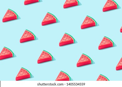 Trendy sunlight Summer pattern made with watermelon fruit on bright light blue background. Minimal summer concept.