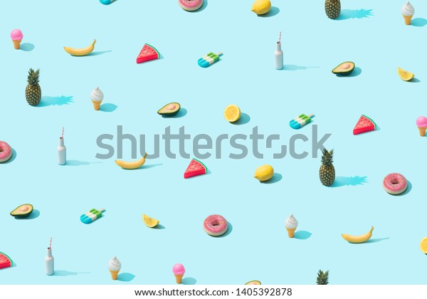 Trendy sunlight Summer pattern made with various summer food on bright light blue background. Minimal summer food concept.