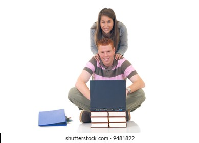 trendy teenager students doing schoolwork on laptop, studio shot, white background, reflective surface