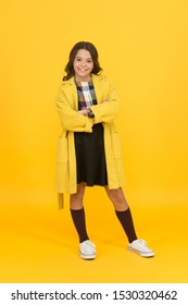 Trendy trench. Classy style. Girl adorable stylish modern teenager. Cool schoolgirl. Charismatic girl on yellow background. Fashion concept. Elegant little schoolgirl. Fashionable schoolgirl.