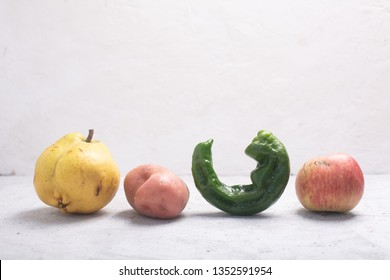 Trendy ugly organic fruits and vegetables on the table. Horizontal orientation