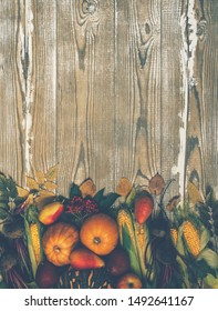 Trendy vegan food, autumn vegetables and fruit. Colorful diet vegetables and fruits. Food background. Healthy food, fresh organic vegetables and fruits. On a wooden background. Copy space. Toned image