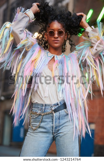 Trendy woman in striped camisole and fringed jacket