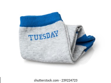 Trendy wool socks with inscription TUESDAY isolated on a white background.