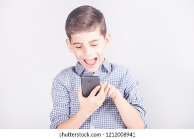 Trendy young boy using his smart phone. Kids and mobile technology concept