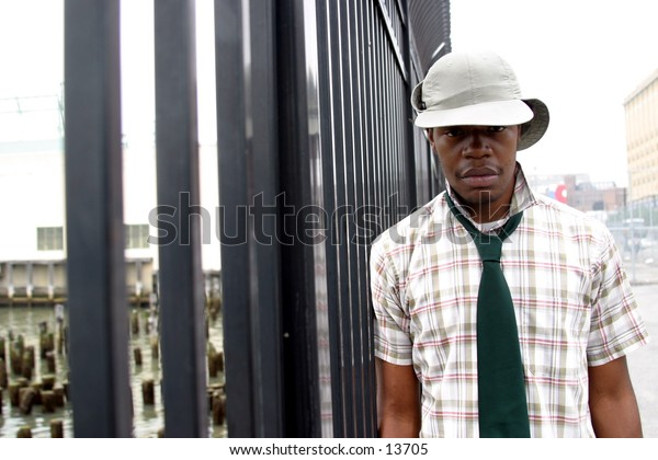trendy young man near fence