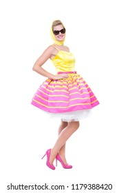 Trendy young woman wearing pink and yellow dress. Isolated on white