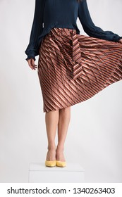 Trendy young woman's leg with flitting skirt. Beauty and fashion conception.
