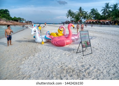 Trengganu, Malaysia. June 24, 2019 : Scene and activity of people or saleman selling floating toys for children at Redang Island coastline.