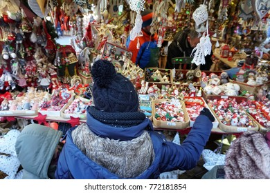 TRENTO, ITALY - DECEMBER 9, 2017 - People buying at the shops of traditional christmas market in the beautiful medieval village