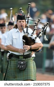 TRENTON, NJ - August 7: A bagpipe band makes their way onto the field prior to the Eastern League minor league baseball game played August 7, 2014 in Trenton, NJ.