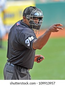 TRENTON, NJ - AUGUST 8:  The home plate umpire of an Eastern League game between Trenton and Reading signals strike two August 8, 2012 in Trenton, NJ.