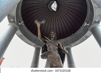 Trenton, NJ - Feb 19, 2018: The bronze Lady Victory sculpture featuring a sword and wreath of peace in her hands stands under the NJ World War II Memorial rotunda in Trenton across the State House.