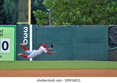 TRENTON, NJ - JULY 21: Reading Phillies outfielder Leandro Castro makes a diving catch in the outfield duringan Eastern League game July 21, 2012 in Trenton, NJ.