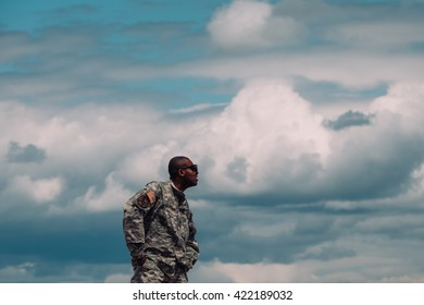 Trenton,NJ - May 15 2016: At a free air show at McGuire AFB, a soldier watches on top of a military Humvee