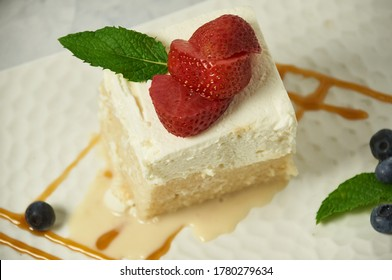 Tres Leche Cake. This dessert is made with egg whites, three types of milk and flavored with Madagascar vanilla bean.  The topping is a mascarpone whipped cream.  A delicious after dinner delight.