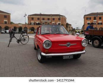 Tresigallo, Italy - May 26, 2019. Vintage car rally in the main square. Fiat 500 Moretti.