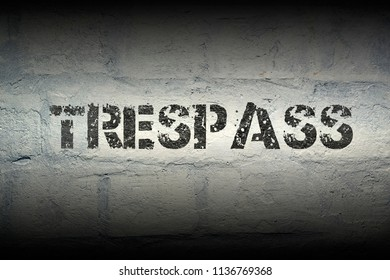 trespass stencil print on the grunge white brick wall