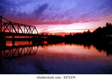 Trestle Bridge and Trees Reflected at Sunset on San Joaquin River, Central Valley, California