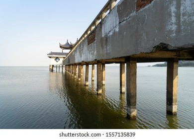 A trestle leading to the center of the water