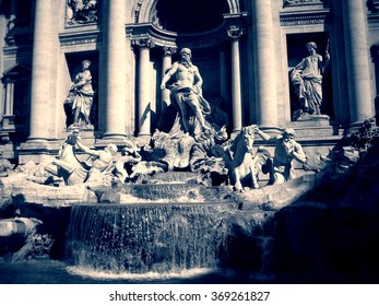 Trevi Fountain in Rome on a sunny day, in black and white. Monochrome image filtered in faded, vintage style with red filter and soft focus; nostalgic concept of travel.