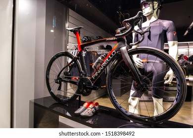 Treviso, Italy - 29/09/2019: Black professional Pinarello Dogma Road Bike on display in official Pinarello bikes shop