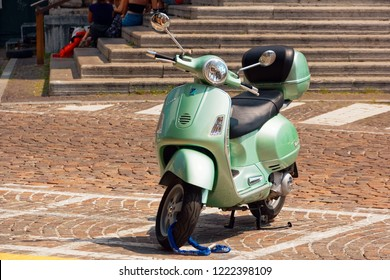 Treviso, Italy August 7, 2018: a moped is parked on a city street.