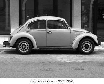 TREVISO, ITALY - CIRCA JULY 2014: Volkswagen Beetle vintage car parked in a street of the city centre.