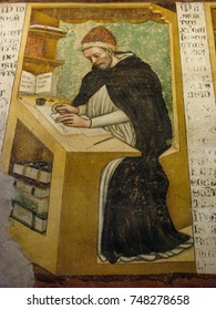 Treviso, Veneto, Italy - July 27, 2011: One of the monks pictured in a fresco in the monastery chapter house of San Nicolo church is this one, seated at a desk copying a manuscript in the scriptorium.