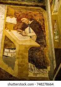 Treviso, Veneto, Italy - July 27, 2011: A fresco in the monastery chapter house of San Nicolo church depicts Hugh of St. Cher, the first recorded image of a person wearing spectacles.
