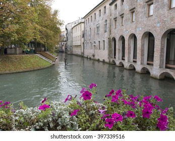 TREVISO,ITALY - SEPTEMBER 29,2014 - Mermaid sculpture on a canal in Treviso in Italy.