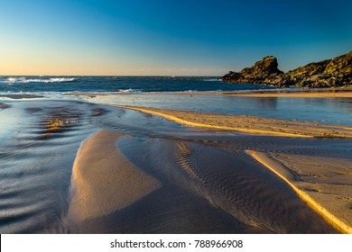 Trevone Bay, Cornwall, UK is a small beached area just a short distance from Padstow, the undulating sands sculpted by a cold norh Easterly wind and aggressive sea swell.