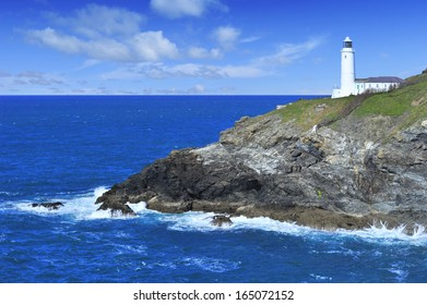 Trevose Head Lighthouse overlooking blue ocean, Cornwall.