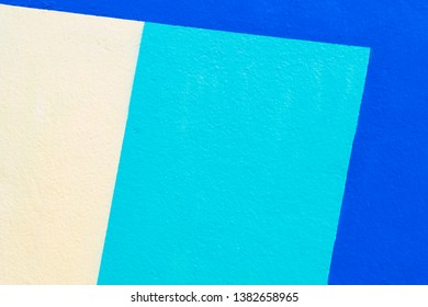 Tri color, white, green and blue color painted on concrete wall for abstract background.