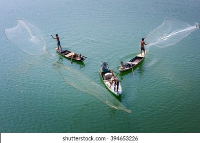 Tri An Lake, Dong Nai Province, Vietnam -  March 6, 2016 : casting a net to catch fish on Tri An Lake. This is the daily work of people from fishing village lakeside