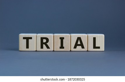 Trial symbol. The word 'trial' on wooden cubes on beautiful grey background, copy space. Business and trial concept.