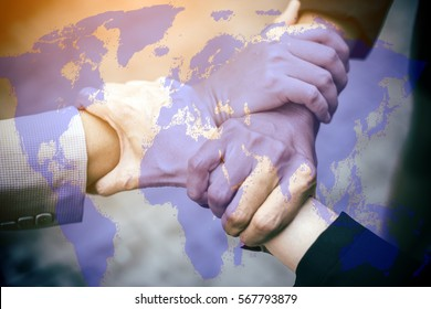 Triange Teamwork Togetherness Collaboration Concept.Top view Hands were a collaboration concept of teamwork.Mix media with World map, globalization business, networking concept.