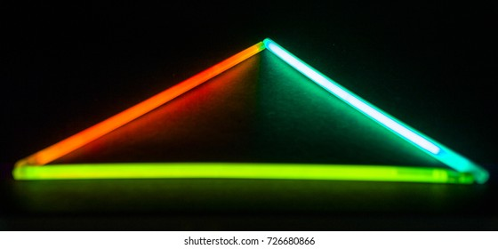 Triangle Glow Sticks on dark ambient