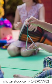 Triangle percussion musical instrument. Music lesson for children