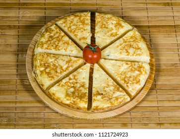 A triangle of potato Spanish omelette on a plate