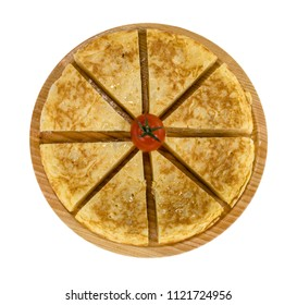 A triangle of potato Spanish omelette on a plate isolated background in white color