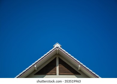 Triangle roof with cloudscape.
