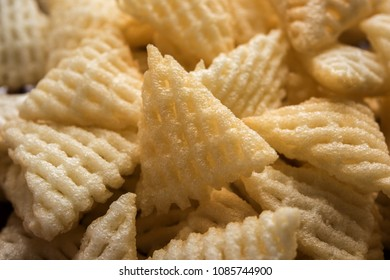 Triangle shape Fryums Papad is a crunchy Snack Pellets served in a bowl