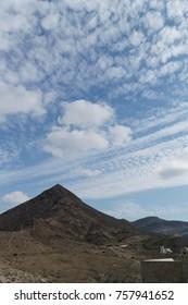 A triangle shaped mountain at seaside in Almeria, Spain