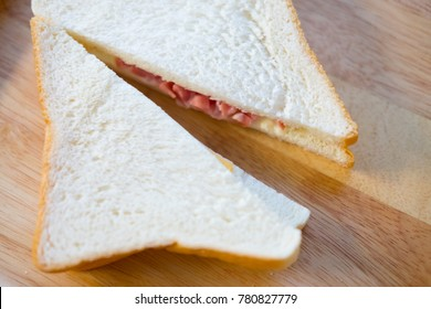 Triangle slice sandwich ham and cheese on wood tray