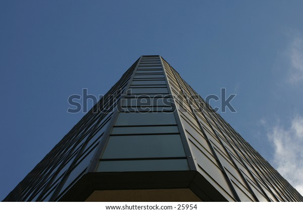 a triangular buidling looking upward.